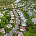 aerial view suburban homes roads early sunrise 73110 6293